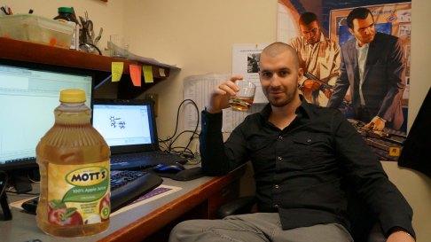 Gab enjoying a refreshing sip of apple juice